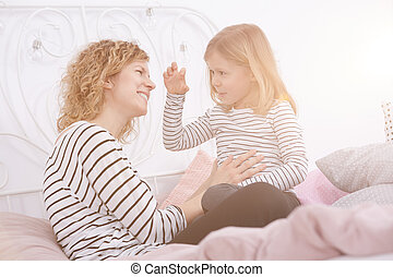 Woman talking with her daughter