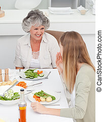 Woman talking with her mother at the table