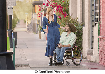 Woman Talking with Man in Wheelchair