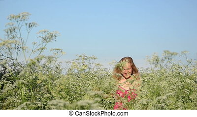 woman tall grass - smiling woman hard crawling through long...