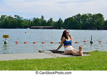 Woman tanning on the lake
