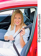 woman taped and reeled on before driving - a young woman is...
