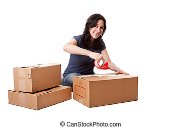 Woman taping moving storage boxes - Attractive happy ...