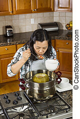 Woman Tasting Her Cooking of the Winter Melon