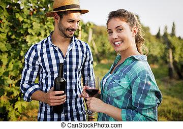 Woman tasting wine in vineyard