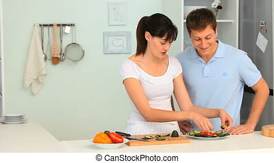 Woman teaching her boyfriend how to cook