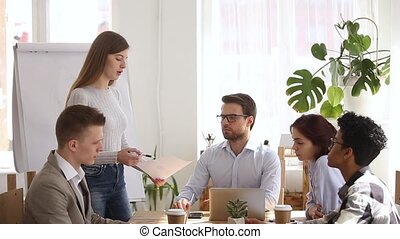Woman team leader reporting work results to colleagues during briefing