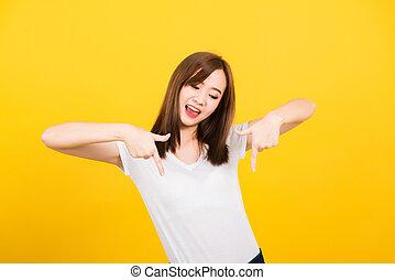 woman teen standing makes gesture two fingers point below