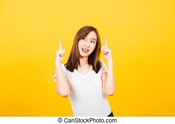 woman teen standing makes gesture two fingers point upwards above