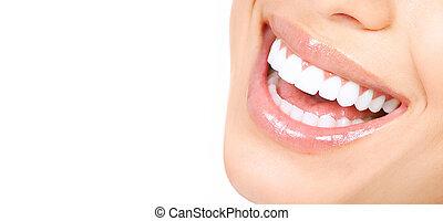 Woman teeth - Beautiful young woman teeth. Isolated over...