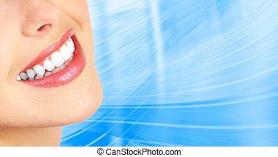 woman teeth - Beautiful young woman teeth. Over blue...