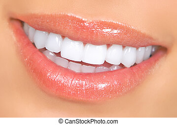 woman teeth - Smiling woman mouth with great teeth. Close up