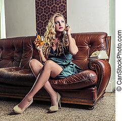 Woman telephoning on sofa