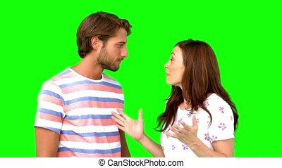Woman telling her friend a massive secret on green screen in...