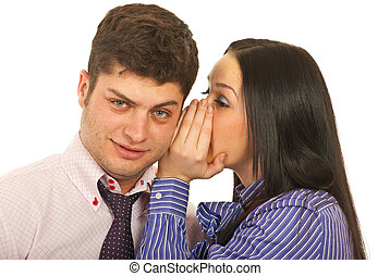 Woman telling secret to man