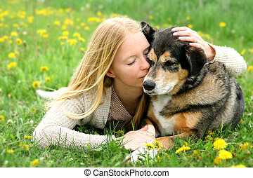 Woman Tenderly Hugging German Shepherd Dog