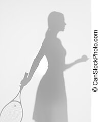 woman tennis player at service, silhouette