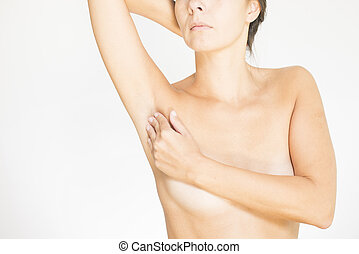 Woman testing her breast for cancer - Close up view of the...