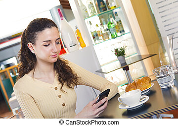 woman texting a message with her smart phone - Portrait of...
