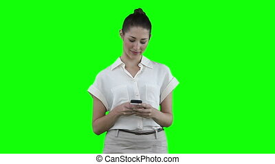 Woman texting on her cellphone before looking to her side