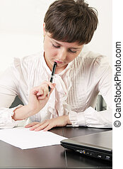 Woman thinking over blank paper