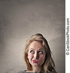 Woman thinking and looking at the left