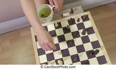 Woman thinking strategy of chess