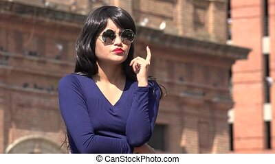 Woman Thinking Wearing Sunglasses And Wig