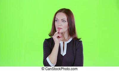 Woman thinks and she has an idea in her head. Green screen -...