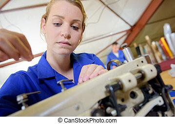 Woman threading sewing machine