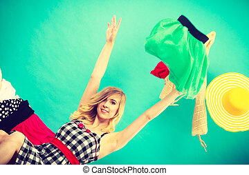 Woman throwing up clothes, clothing flying everywhere - ...