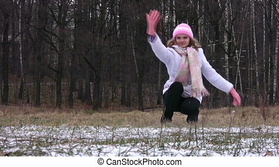 Woman throws first snow.
