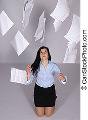 Woman throws out paper into the air
