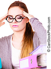 woman tired with stack of folders documents