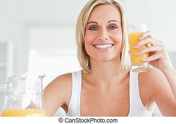 Woman toasting with orange juice