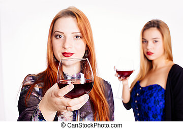 Woman toasting with red wine