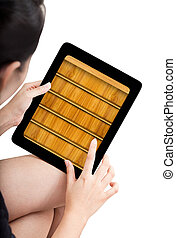 Woman toch application shelf of ebook on modle tablet pc