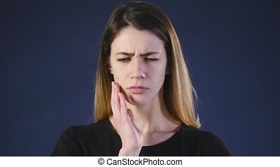 Woman toothache. Gray background