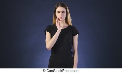 Woman toothache. Gray background - Woman toothache emotions...