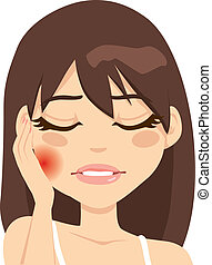 Young woman suffering toothache pain pressing her cheek with a painful expression