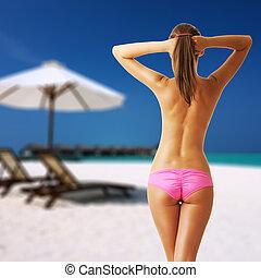 Woman topless on beautiful beach at Maldives, South Male...