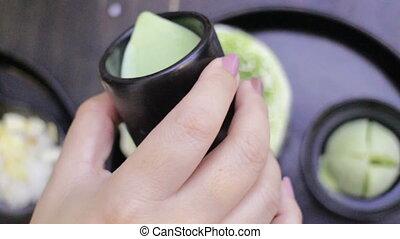 Woman Topping Green Tea Sauce Of Iced Dessert