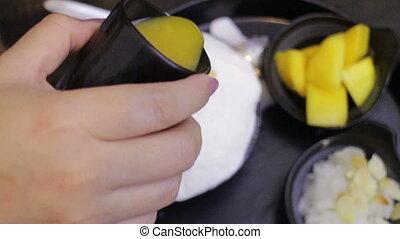 Woman Topping Mango Sauce On Dessert, stock video