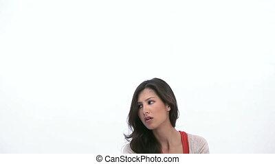 Woman toppling a bin on her head