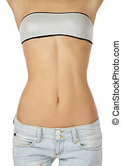 Woman torso - Torso of slim tanned woman in blue jeans over ...