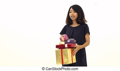 Woman tosses a lot of gift box