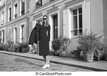 Woman total red outfit enjoy walk beautiful street Paris. Parisian carefree walks on sunny day. Lets walk. Leisure and cultural attractions in Paris. Guide to spare time in French capital