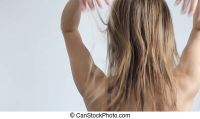 Woman touch her hair