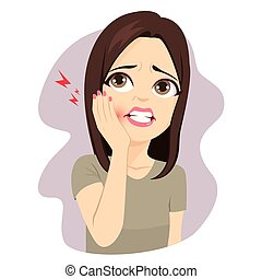 Young woman touching cheek with hand suffering toothache pain