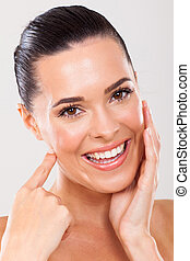woman touching healthy face skin